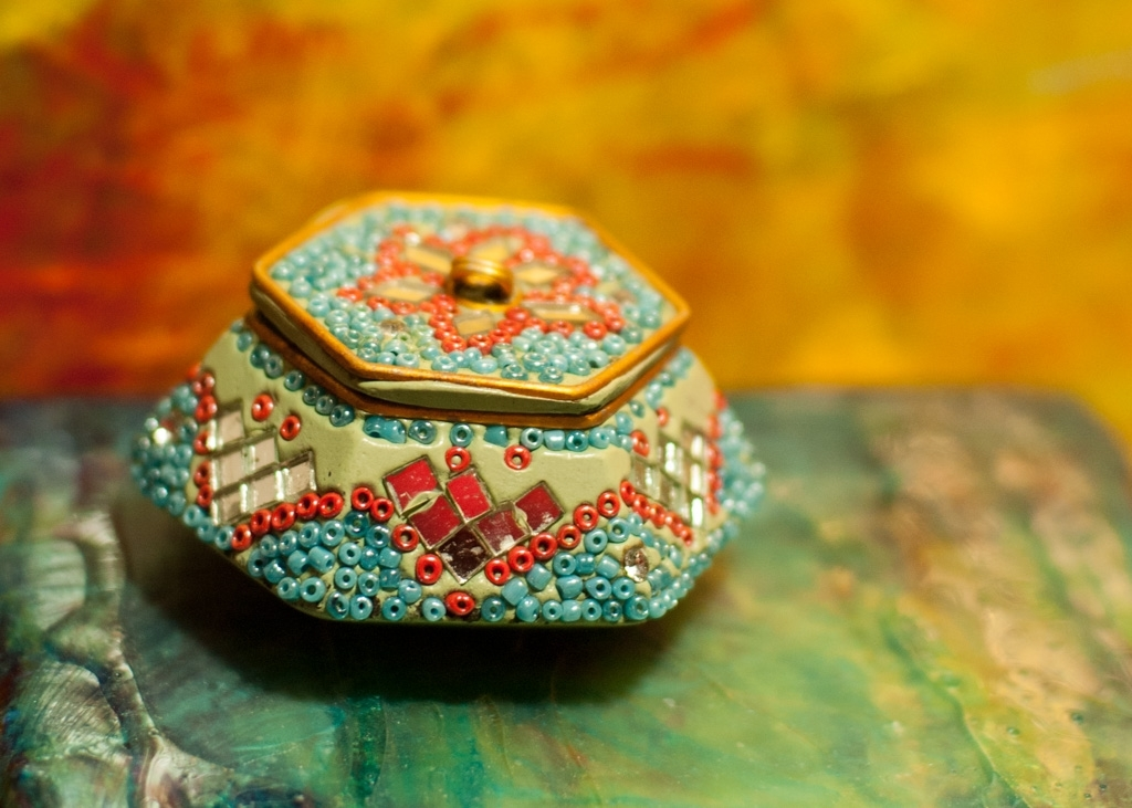 box made of mosaic of little colorful bits